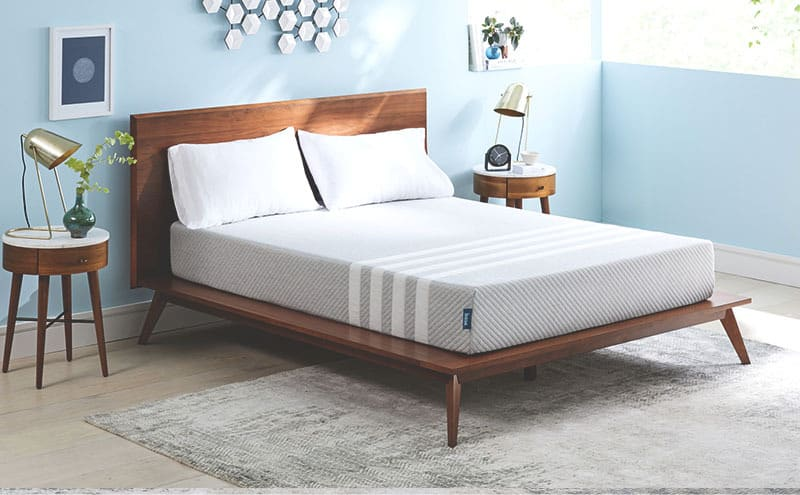 the leesa mattress on a wooden bedframe from an angle