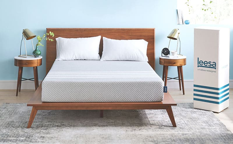 the leesa mattress on a wooden bedframe